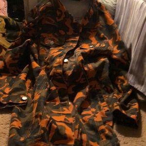 Oversized camouflage denim jacket.